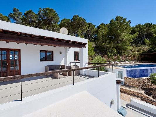 View of terrace and pool photo - Casa Kiva: 6 bedroom child friendly luxury villa with infinity pool in Es Cubells, Ibiza