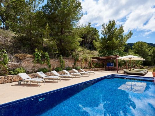 View of pool and sunbeds photo - Casa Kiva: 6 bedroom child friendly luxury villa with infinity pool in Es Cubells, Ibiza