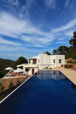 View of villa and pool photo - Casa Kiva: 6 bedroom child friendly luxury villa with infinity pool in Es Cubells, Ibiza