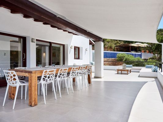Outdoor dining photo - Casa Kiva: 6 bedroom child friendly luxury villa with infinity pool in Es Cubells, Ibiza