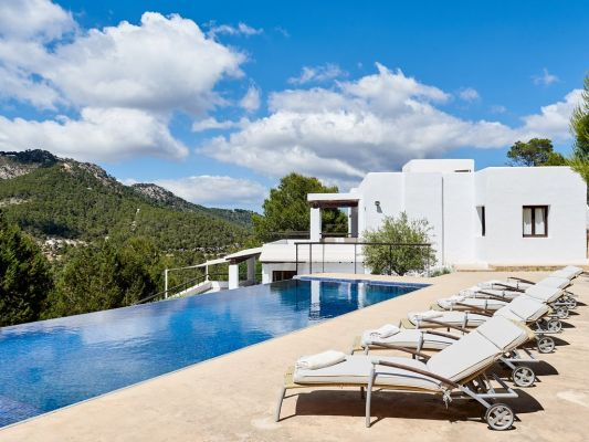 View of sunbeds and pool photo - Casa Kiva: 6 bedroom child friendly luxury villa with infinity pool in Es Cubells, Ibiza