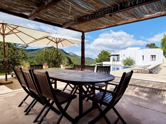 Covered seating outdoor space photo - Casa Kiva: 6 bedroom child friendly luxury villa with infinity pool in Es Cubells, Ibiza
